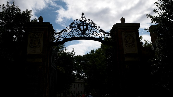 A general silhouette view of one of the many gates to the Harvard University campus