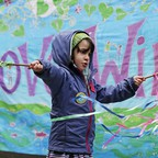 A photo of a child waving home-made flags during a rally by youth activists and others in support of a high-profile climate change lawsuit in Seattle..