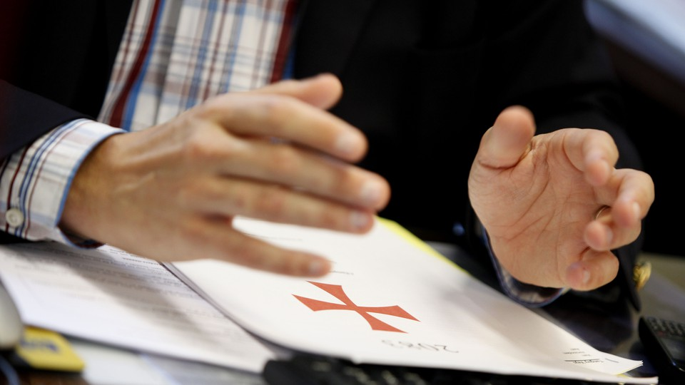 The Flemish right-wing party member Tanguy Veys holds his hands over a copy of Anders Behring Breivik's manifesto.