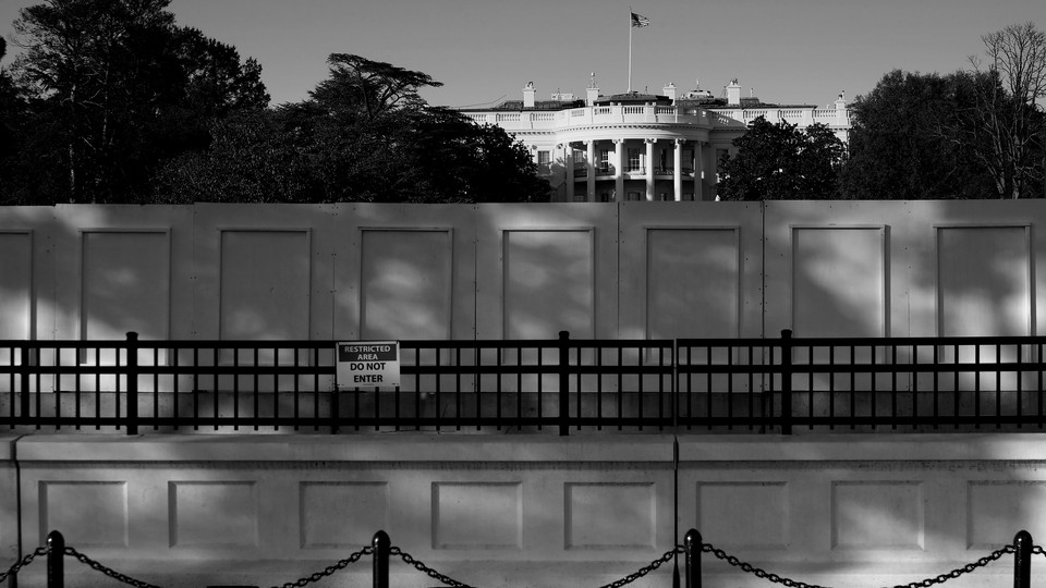A view of the White House obscured by a wall