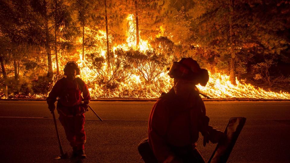Firefighters battle the King Fire near Fresh Pond, California, in September 2014.