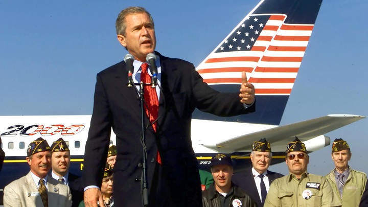 George W. Bush, standing in front of his campaign airplane, addresses supporters during a campaign rally in October 2000.