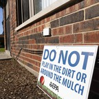 In East Chicago, Indiana, where lead levels in the soil are high, EPA signs warn against contact with the dirt.