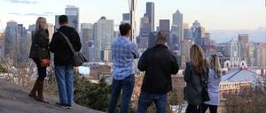 Onlookers survey the skyline of Seattle, Washington.