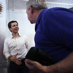Presidential candidate Pete Buttigieg shakes hands with a man.