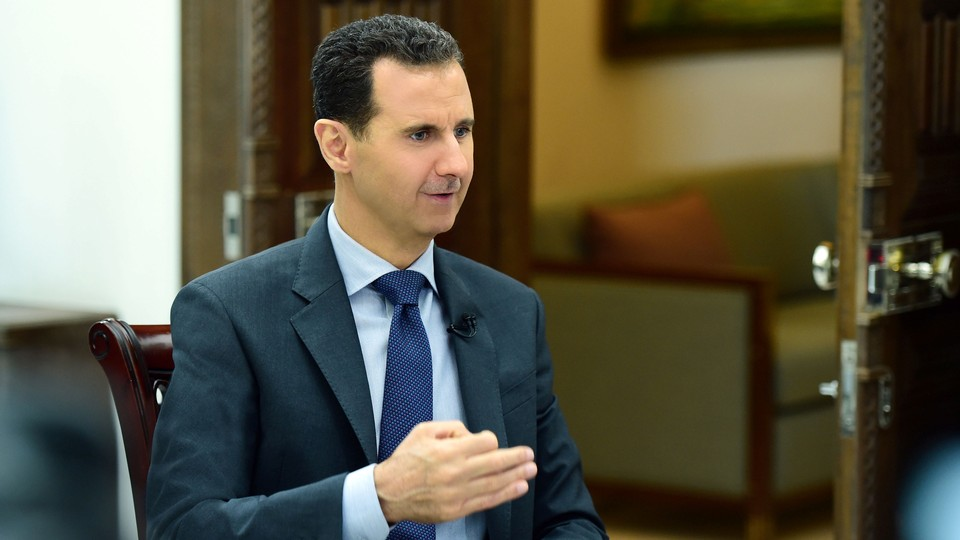 SyrianPresident Bashar al-Assad speaks during an interview with RIA Novosti and Sputnik in this handout picture provided by SANA on April 21, 2017.