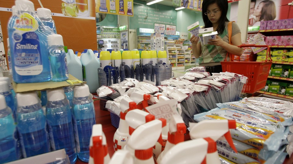 A customer looks at face masks in the antiflu section at a supermarket in Taipei.