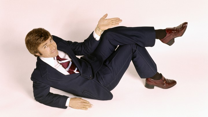 A man in a suit reclining
