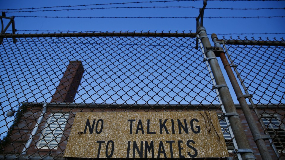 """A jail with the sign """"No Talking to Inmates"""""""