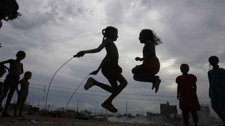 Two children play jumprope.