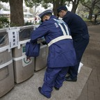 A photo of police officers sealing off trash bins prior to the Tokyo Marathon in Tokyo in 2015.