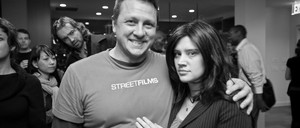 A photo of Clarence Eckerson, the director of Streetfilms, with a pre-fame Kate McKinnon in costume as Veronica Moss, auto industry lobbyist.