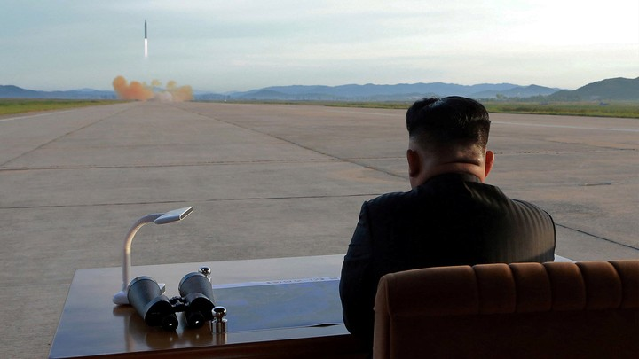 Kim Jong Un watches the launch of a Hwasong-12 missile.