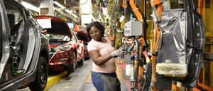 photo: woman working in auto factory