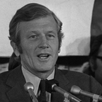 Former New York Mayor John V. Lindy in front of a podium