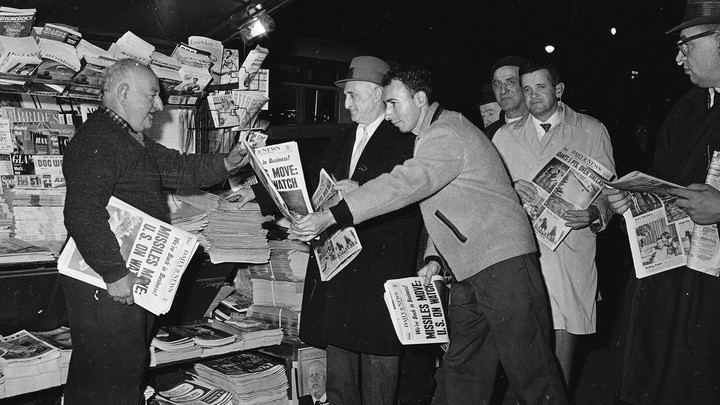 New Yorkers stop to glance at the four-star final edition of the New York Daily News in November 1962.