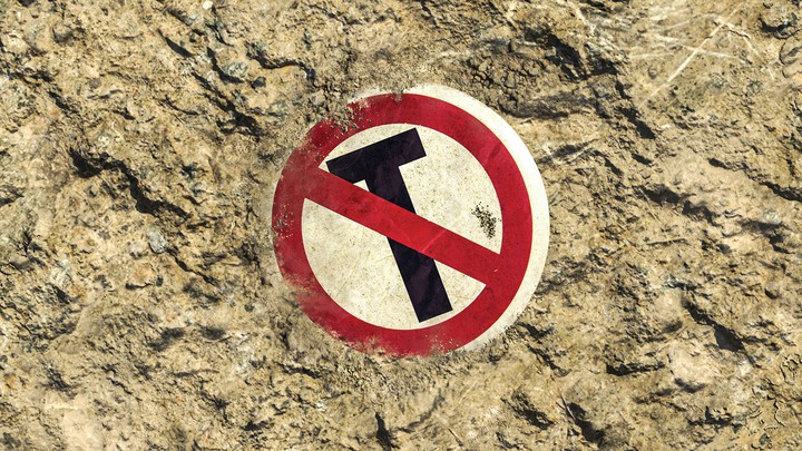 photo of a sign in the sand