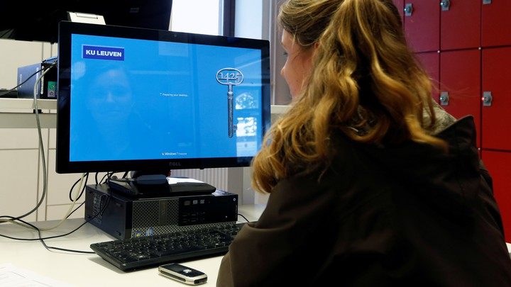 A student sits at a computer.