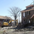 a photo of a house demolition in Detroit