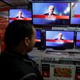 An Afghan man watches the broadcasting of the 2016 U.S. presidential election results on TV in Kabul, Afghanistan November 9, 2016.