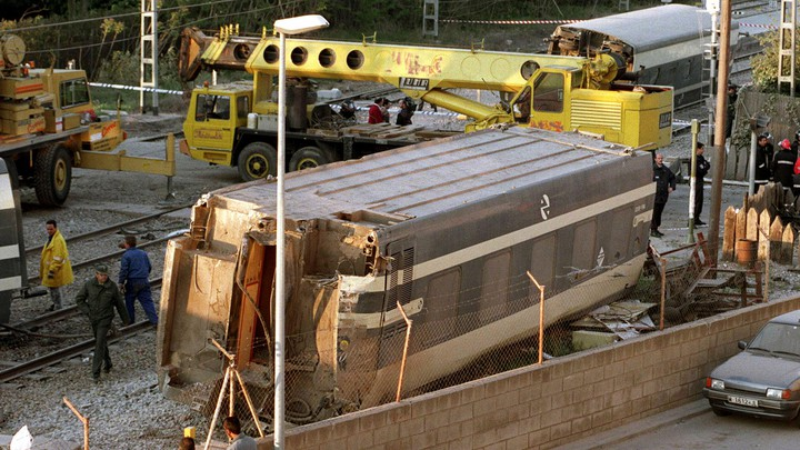Workers clean up the wreckage of a train crash in Spain on September 9.