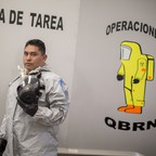 Mexico City Police Emergency Officer in a hazmat suit