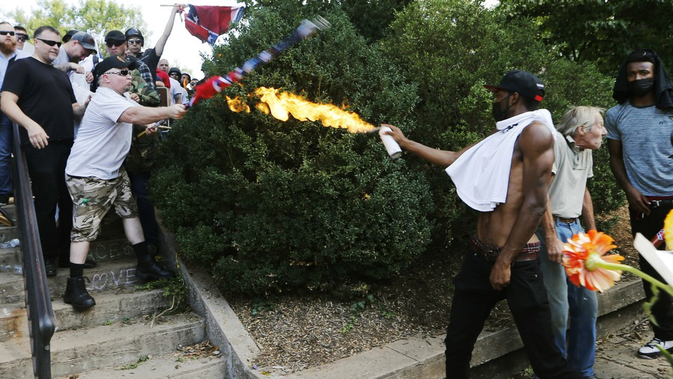 Corey Long sprays a makeshift flamethrower at white nationalist demonstrators