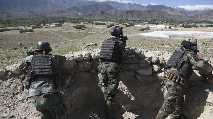 Afghan commandos are positioned in Pandola village near the site of a U.S. bombing in the Achin district of Jalalabad, Afghanistan.