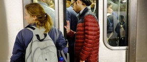 A photo of NYC subway riders.