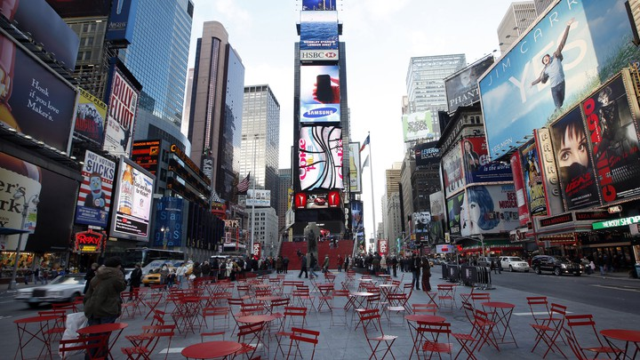 Empty red chairs in the middle of New York's Times Square