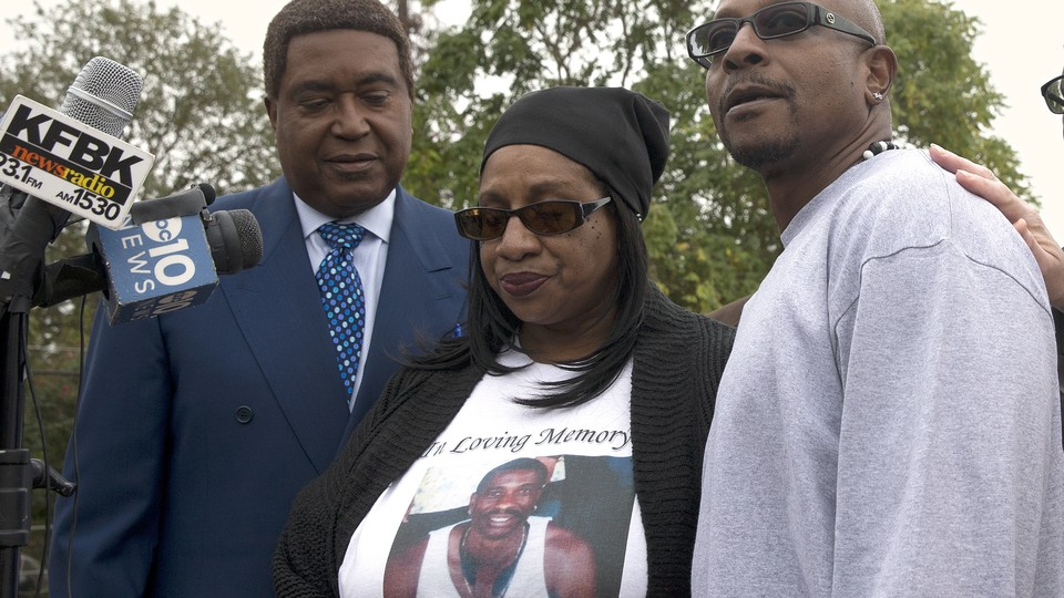 Robert Mann, right, the brother of Joseph Mann, who was killed by Sacramento Police in July, discusses the shooting of his brother during a news conference Monday, Oct. 3, 2016, in Sacramento, California.