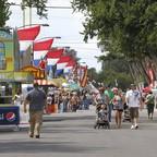 A photo of food stalls and visitors at the Colorado State Fair in Pueblo, Colorado.