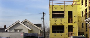 A multi-family home being built next to a single-family home in Seattle.
