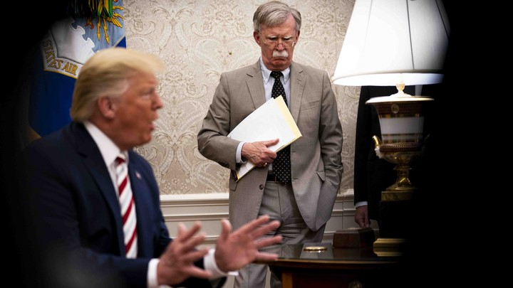 John Bolton, the national-security adviser, watches as President Donald Trump host the Romanian president in the Oval Office.