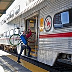 photo: a bike rider boards a Caltrain train in 2009.
