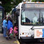 A TriMet bus stopping for passengers at a bus stop, in Hillsboro Oregon.