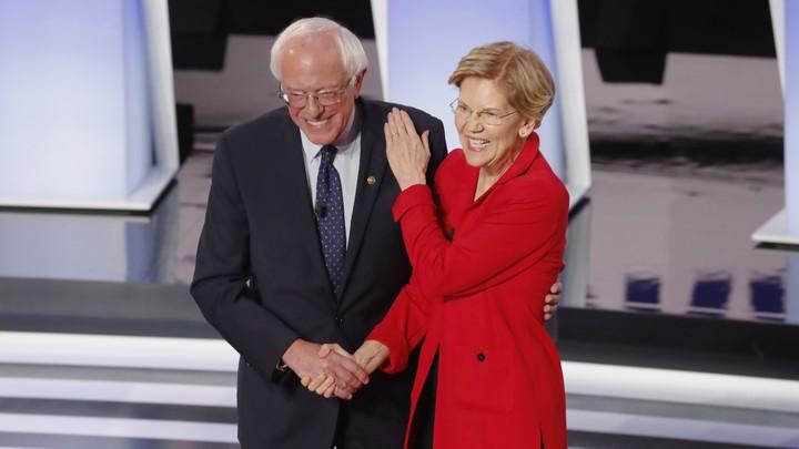 Senators Bernie Sanders and Elizabeth Warren greet each other on the debate stage in Houston, Texas.