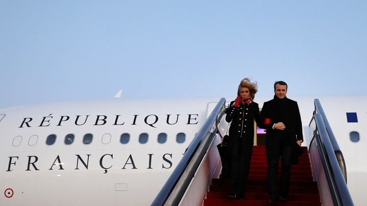 President Emmanuel Macron and his wife Brigitte Macron arrive at Beijing Capital Airport.