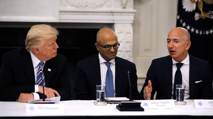 President Donald Trump, Satya Nadella of Microsoft, and Jeff Bezos of Amazon