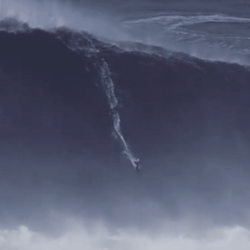 Maya Gabeira surfs a 73.5-foot wave on February 11 in Nazaré, Portugal.
