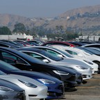 Tesla vehicles sit in a parking lot in California.