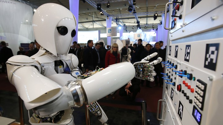 The humanoid robot AILA (artificial intelligence lightweight android) operates a switchboard