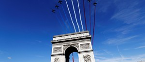Planes stream above Paris's Place de L'Étoile in celebration of Bastille Day