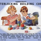 Vintage toy-box lid showing children playing with building cubes