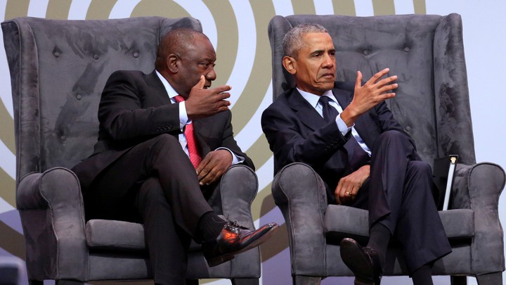 Cyril Ramaphosa and Barack Obama sit together during a discussion in Johannesburg in July.