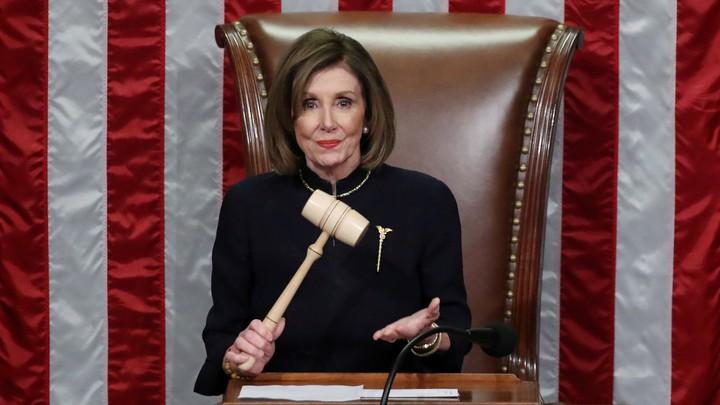 Nancy Pelosi holding a gavel