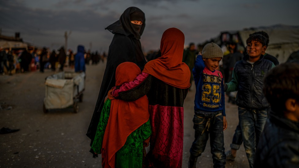 A veiled woman looks back at the camera in the al-Hol camp in northern Syria.