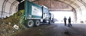 A truck dumps compost materials inside a receiving area at the Cedar Grove processing facility near Seattle, Washington.