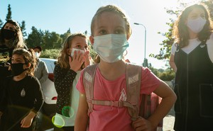 Photo of several children and a few adults wearing face masks