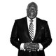 T. D. Jakes poses for a black-and-white portrait.